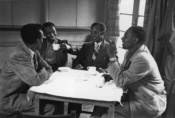 A group of Somalis meet for a drink and a smoke at a cafe in Tiger Bay, 1950