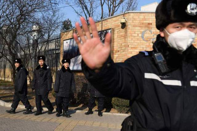 December 2018: Chinese police patrol outside Canada's embassy in Beijing
