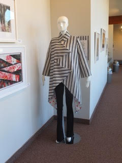 Coat and pant design by Barbara Arata-Gavere in the exhibition, created based on her husband's work, also displayed in the show.