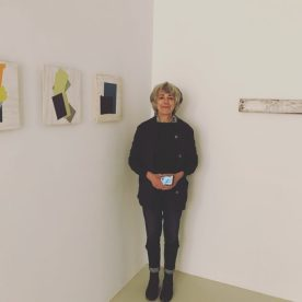 Jean Feinberg with her artwork at Beth Urdang Gallery