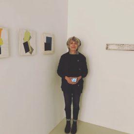 Jean Feinberg with her artwork at Beth Urdang Gallery