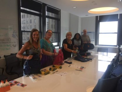 staff members working on backpacks for Operation Backpack