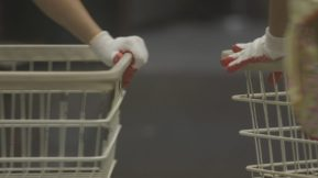 still from The Washing Society featuring a closeup of two laundry carts