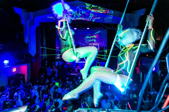 Burke and Sapozhnikova swing on trapezes at the House of Yes (Photo: Sasha B. Photo, Photography '09)