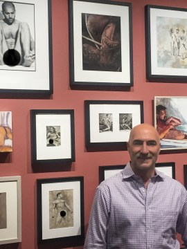 Ron Amato standing in a gallery