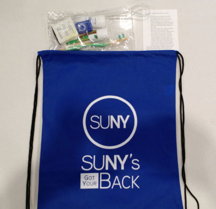 SUNY's Got Your Back backpack with toiletries coming out of the top