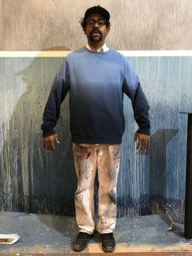 "Ortiz calls the walls of the longue his largest painting, ""After I finished I realized it matched my favor sweatshirt!"""