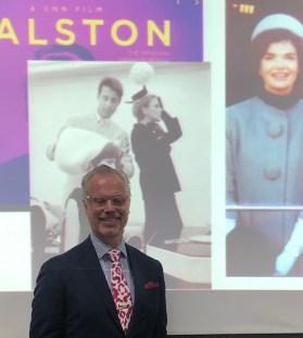 Carl Rutberg standing in front of presentation screen