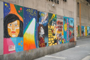 brightly colored mural on facade of building
