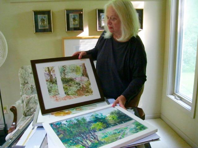 Kinstler Ney flips through some of her paintings.