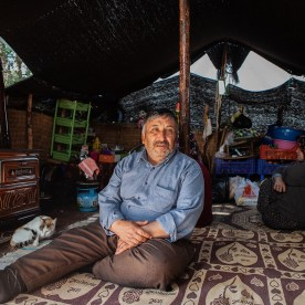 "Though popular Kilims and carpets/rugs come from the region, the Yörüks live a largely isolated existence. The woman in the background of this photograph said, ""No one comes to visit us in these mountains. It's been two years since I've seen a human being who is not part of my family."""