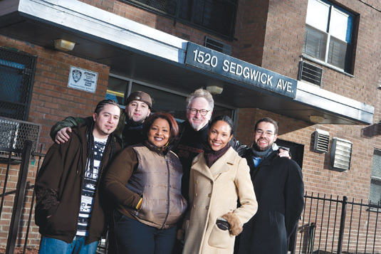 Born in the Bronx: Members of the Bronx African American History Project and the hip-hop group Rebel Diaz gathered at the birthplace of the genre. From left to right: Rodstarz, G1, and Lah Tere, of Rebel Diaz; Fordham professors Mark Naison, Ph.D., Oneka LaBennett, Ph.D., and former Fordham professor Brian Purnell, Ph.D.. Rebel Diaz will be performing at the BAAHP's anniversary celebration on April 6. Photo by Bud Glick