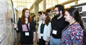 """Psychology student Laura Frank, and biology students Olivia Giannakopoulos and Ian Villagran share findings from their research project, """"The Effect of Drey Presence on Flight Initiation Distance in the Eastern Gray Squirrel (Sciurus carolinensis) in New York City"""" at the 2017 Undergraduate Research Symposium on April 26 at the Rose Hill campus."""