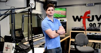 Fordham senior John Furlong stands in a studio at WFUV, where he has worked as a sports reporter and producer, gaining experience alongside pros in New York media.