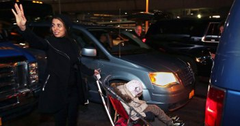 Fahimeh (Farimah) Kashkooli waves goodbye as she and Alma leave the airport.