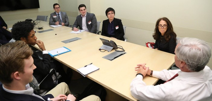 Brian C. Rogers, non-executive chairman of T. Rowe Price, meets with students from the Gabelli School of Business before delivering a talk on his 37-year career in investment management.
