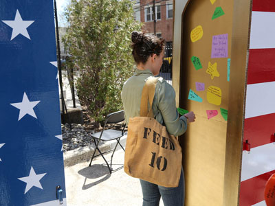 """Attendees of Bronx Celebration Day share their cultural roots as part of South Korean artist Sohhee Oh's mobile communal art project, """"The Golden Door."""""""
