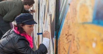 Tourists sign the 'peace wall' in Belfast in 2014.