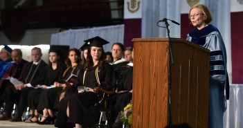 Maura Mast, Dean of Fordham College at Rose Hill, addresses Encaenia 2018 at the Rose Hill Gymnasium