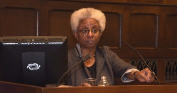 Mary Shawn Copeland speaks to the audience from a podium.