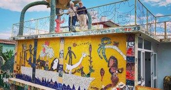 A couple of alumni atop the Fusterlandia public art installation in Havana, Cuba