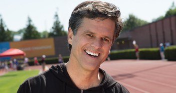 Timothy Shriver, Board Chair of the Special Olympics, in a black hoodie on an athletic track/field