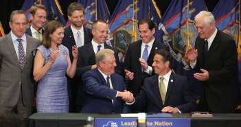 Al Gore shakes Andrew Cuomo's hand during a signing ceremony at Fordham Law School