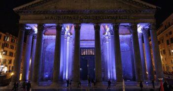 The Pantheon lit in purple light at night