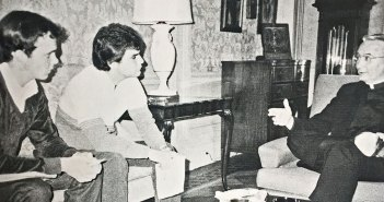 A black-and-white 1984 photo shows two Fordham student journalists, John Breunig and Dan Vincelette, interviewing Joseph A. O'Hare, S.J., then the new president of Fordham, in the president's office at Rose Hill.