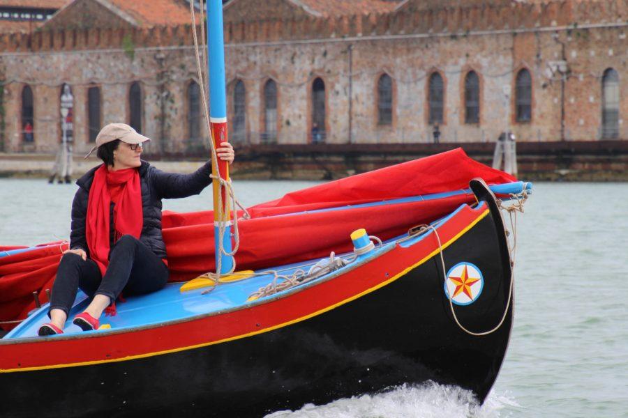 Artist Melissa McGill rides in one a vela al terzo during a regatta. Courtesy of Melissa McGill