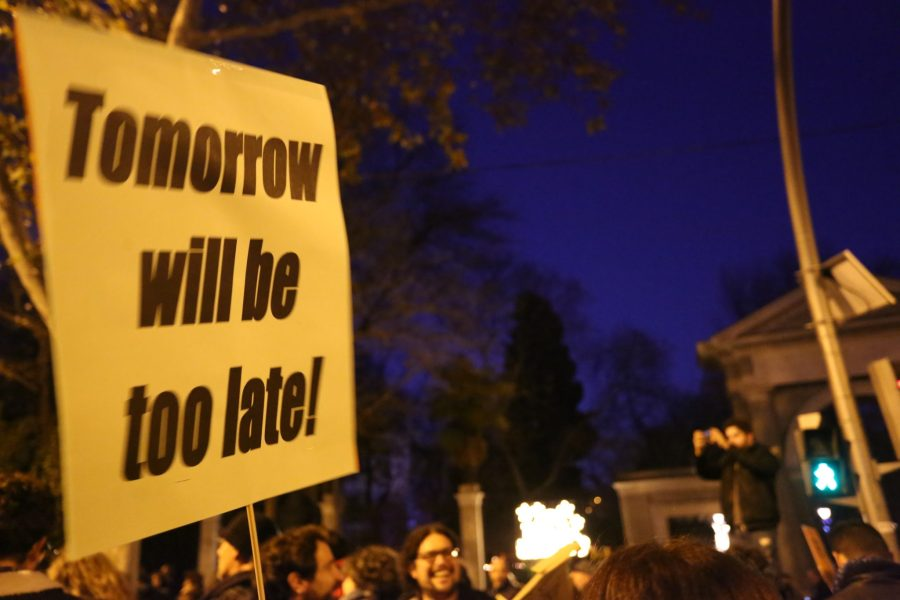 "A sign reads: ""Tomorrow will be too late!"" Melissa Kaye Angel, GLF"