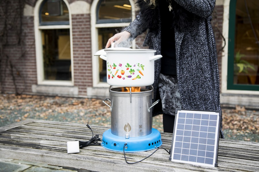 The solar energy used to power the stoves can also be used to charge cell phones. Courtesy of African Clean Energy