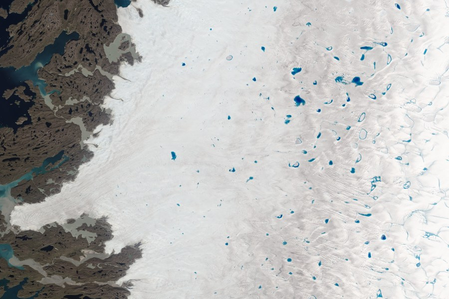 Meltwater lakes on the ice near Greenland's west coast, captured in 2015. NASA Goddard Space Flight