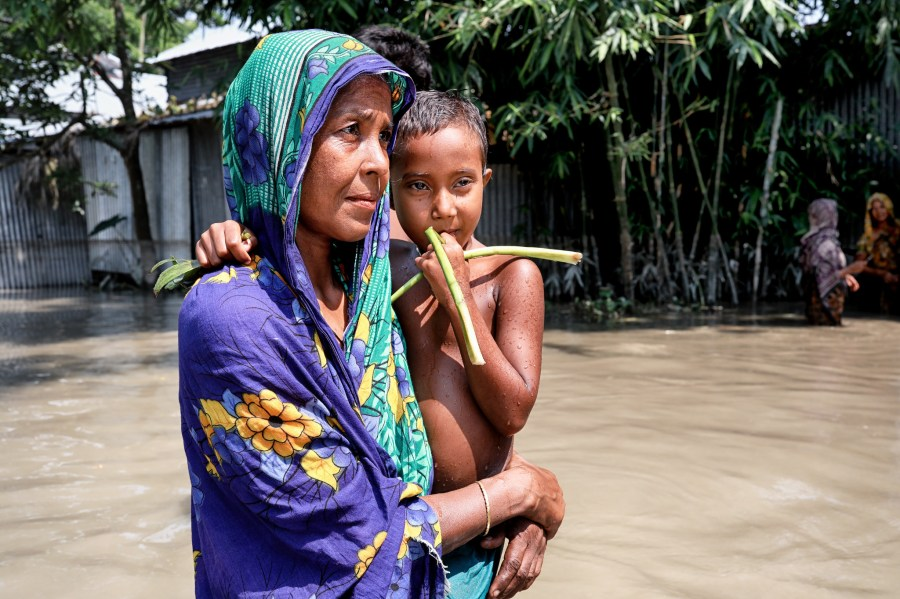 A woman flees her home in the midst of last year's floods in Bangladesh. The ongoing floods this year are worse. UN Women Asia and the Pacific