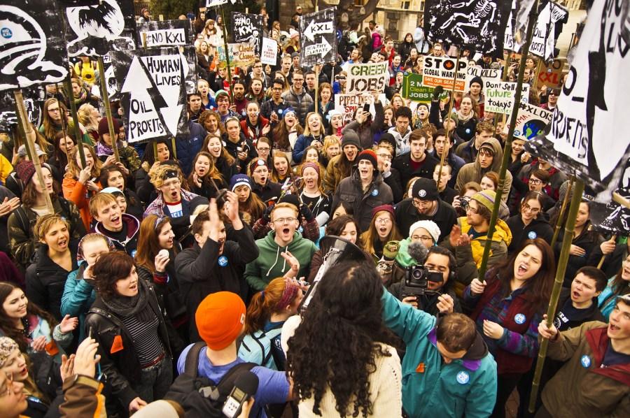 Varshini Prakash, center, addresses a crowd of activists. Prakash has focused on intersectionality in the Sunrise Movement she founded. Joe Brusky, Flickr