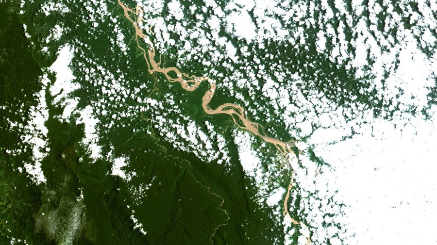 Clouds over the Ucayali River, a tributary of the Amazon River, and surrounding rainforest. Lighter green areas denote where forest has been cleared to develop land for agriculture. Coordenação-Geral de Observação da Terra/INPE