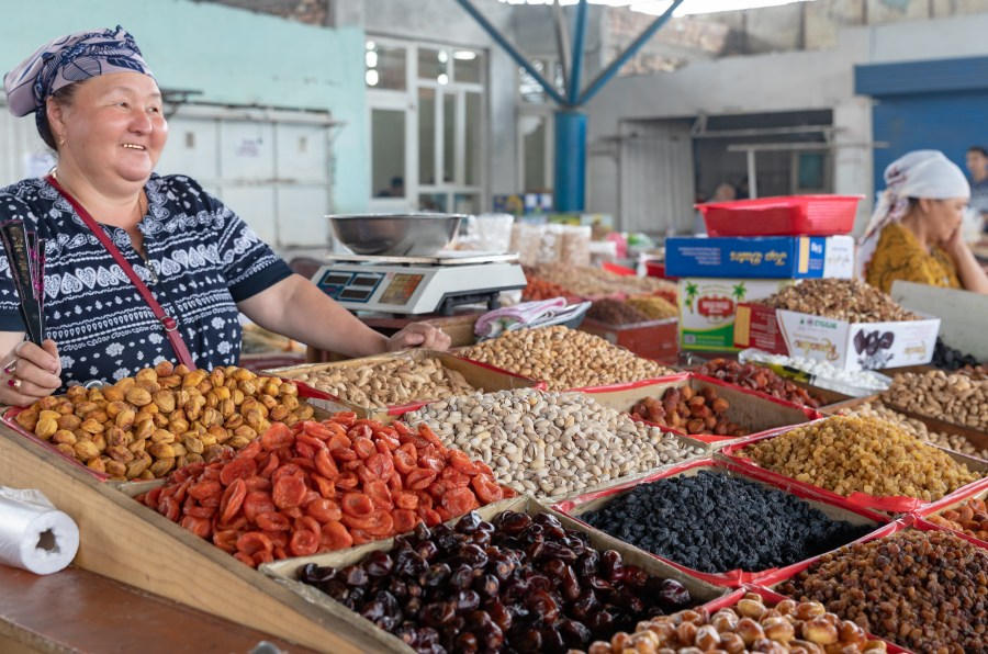 A Kyrgyz woman sells a variety of dried fruits and nuts at the bazaar in Uzgen, one of Central Asia's oldest cities. Ninara, Flickr