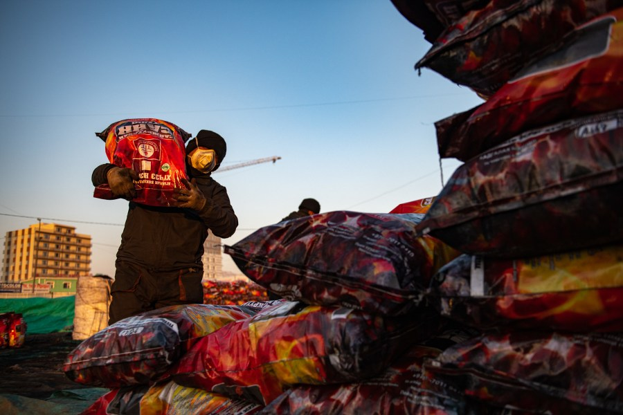 Coal briquettes, which emit less smoke and ash compared to raw coal, being packed in Ulaanbaatar. Asian Development Bank, Flickr