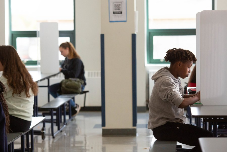 High school students eat a socially distanced lunch during October 2020 during the COVID-19 pandemic. Allison Shelley, EDUimages