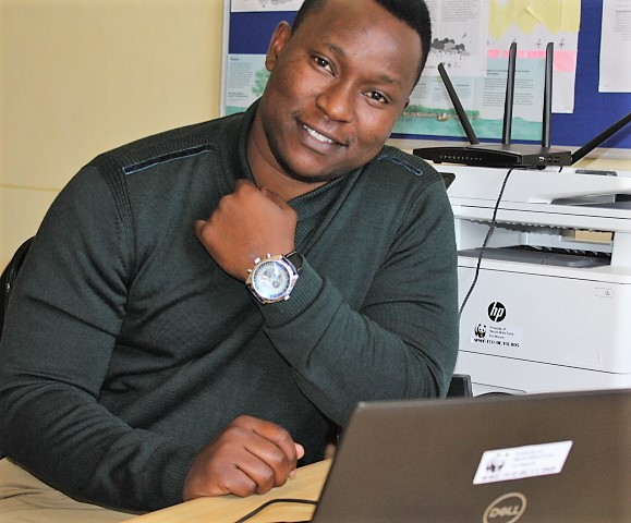Conservationist Azaria Kilimba works in his office. WWF Tanzania