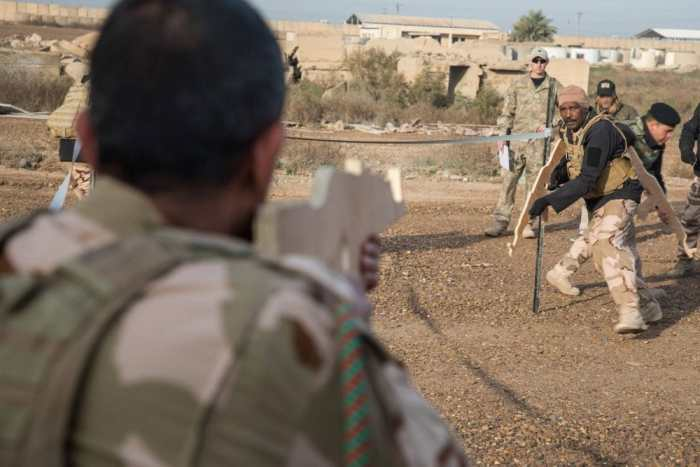 Dummy wooden AK47s in the hands of Iraqi security forces