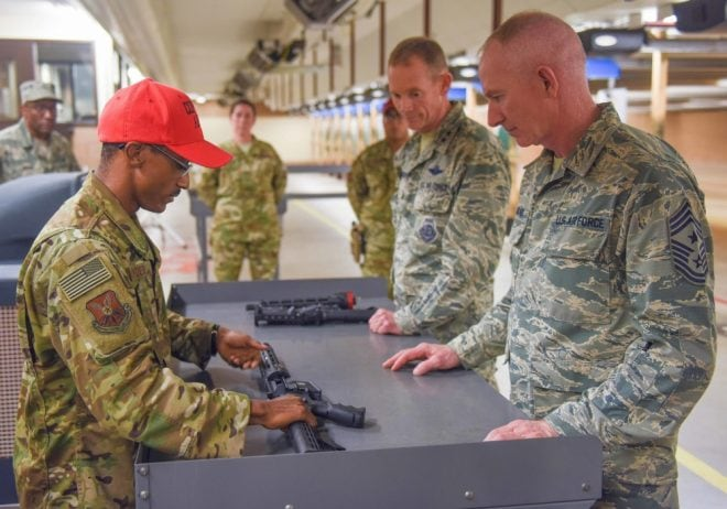 A USAF Security Forces combat arms instructor shows Maj. Gen. James Dawkins Jr., 8th Air Force commander, and Chief Master Sgt. Alan Boling, 8th Air Force command chief, how to assemble an Aircrew Self Defense Weapon at Dyess Air Force Base, Texas, Oct. 4, 2018. (Photo: USAF)