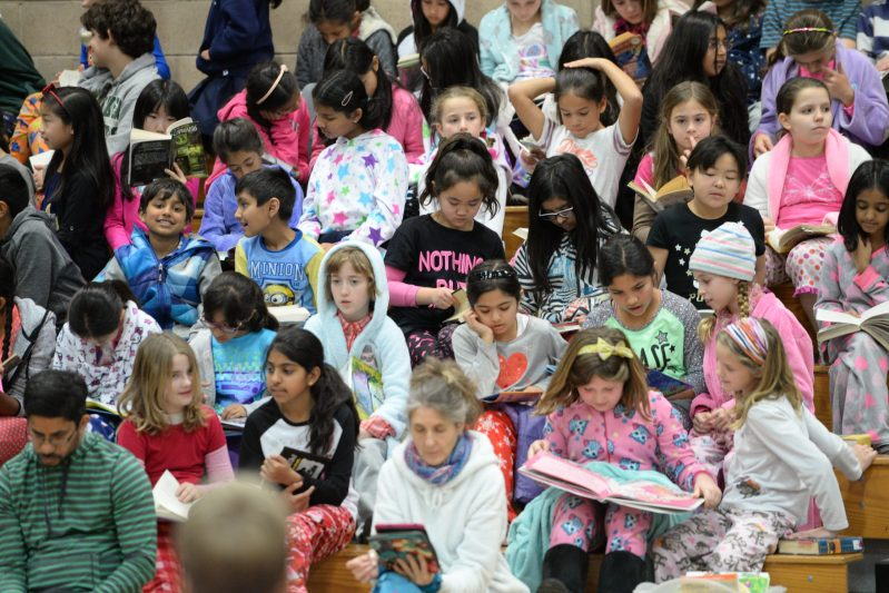 Upper And Lower School Students Bond Over Books During Pajama Day Assembly