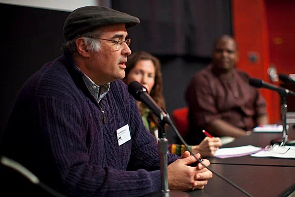 Among the panelists were Seth Kalichman (from left), professor of psychology at the University of Connecticut; Nicoli Nattrass, director of the AIDS and Society Research Unit and economics professor at the University of Cape Town in South Africa; and Pride Chigwedere, a global health consultant and former Oak Foundation Research Fellow at Harvard AIDS Initiative.