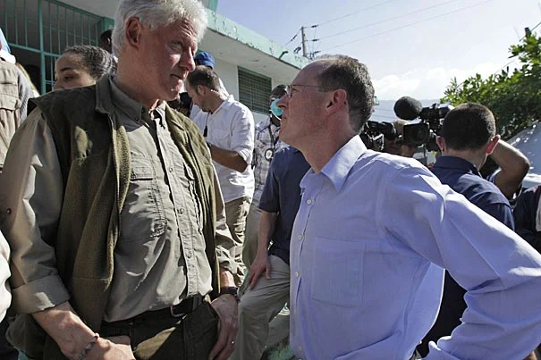 Former president and U.N. special envoy for Haiti Bill Clinton (left) talks to Paul Farmer while touring the General Hospital in Port-au-Prince Monday (Jan. 18). Partners In Health (PIH), a not-for-profit Harvard affiliate co-founded by Farmer, has taken the lead in University-related medical aid.