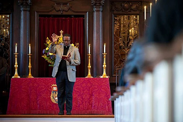 The Rev. Gabriel Michel leads the benediction to close a memorial service for the victims of the Haiti earthquake at the Memorial Church.