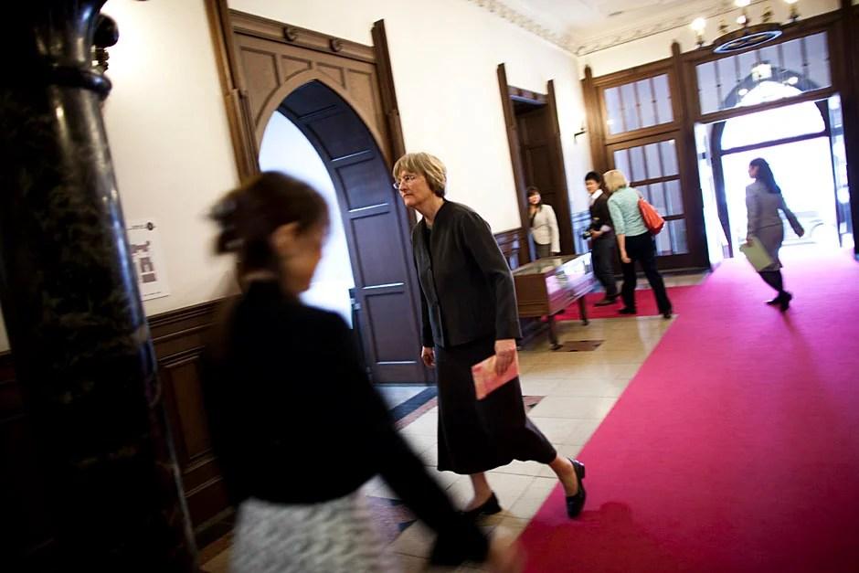 Faust walks through the Mita Campus Old University Library.   Stephanie Mitchell/Harvard Staff Photographer