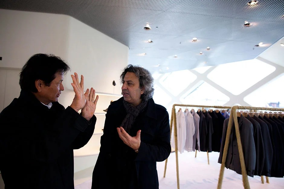 Faust tours the architectural sights of Tokyo, including the Louis   Vuitton, Tod's, and Prada buildings, with Harvard Design School Dean Mohsen Mostafavi. Here, Makoto Hoshino (from left) and Mostafavi discuss the design of the Prada building. Stephanie Mitchell/Harvard Staff Photographer
