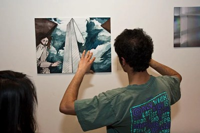 "(Cambridge, MA - April 1, 2010) -  Abhishek Bose-Kolanu '11 looks at ""Skyscape"" by Shannon Mulshine at the opening at CGIS for ""Invisible Cities,"" a student art show on display April 1-20, about journeys and cities both real and imagined,  focusing on the emotional aspects of experiencing a place. Organizers and co-creators of the show are Nancy Lin '11 and Anne Sawyier '11. Staff photo Jon Chase/ Harvard University News Office"