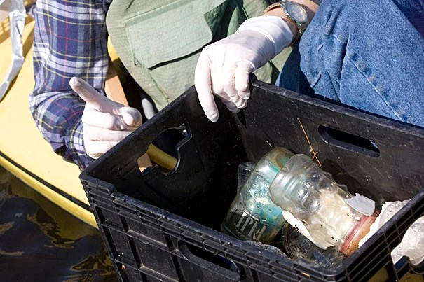 During Earth Week, Harvard staff and students help clean up along the Charles River as part of its environmental outreach, which has grown over the years.